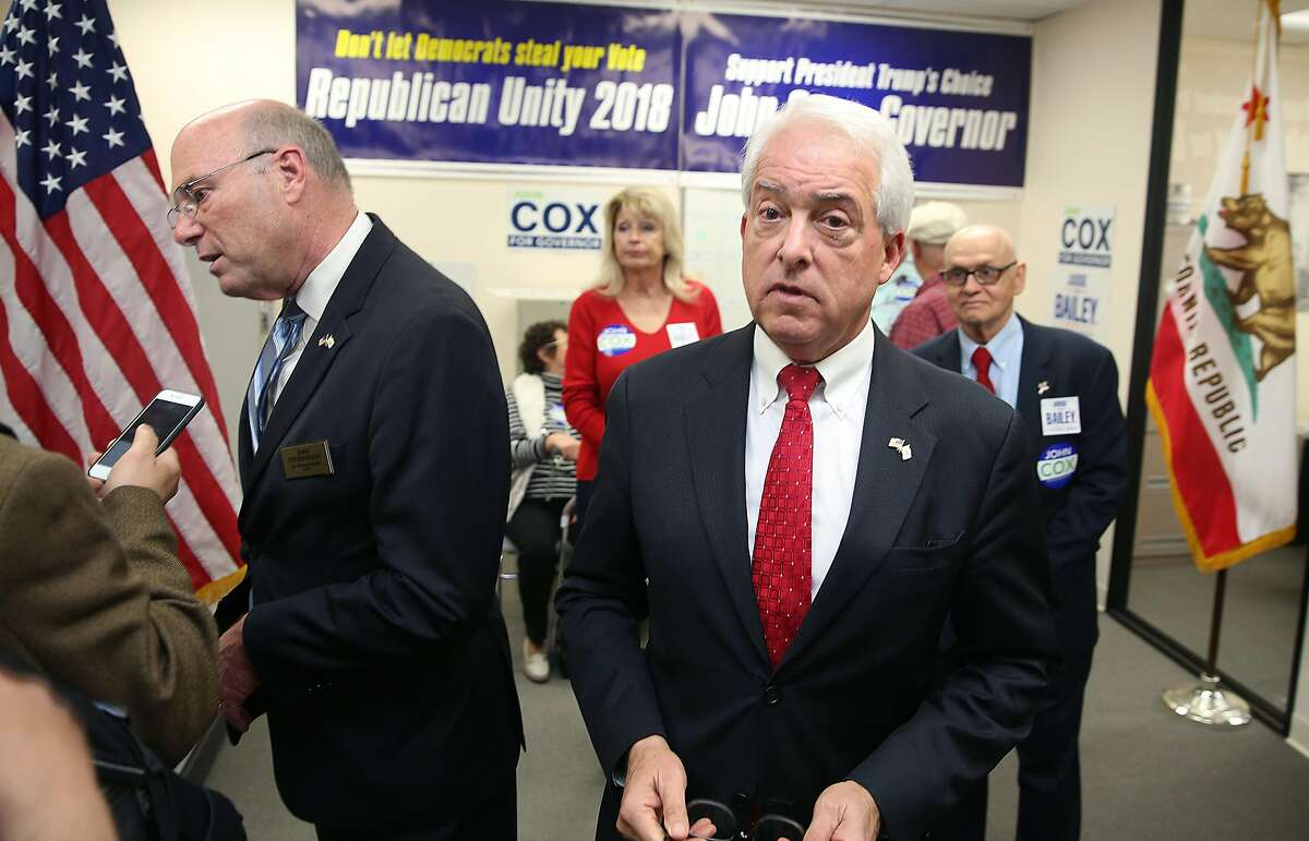 GOP candidates, John Cox (right middle) for governor and Steve Bailey (left) for attorney general have a press conference at the San Mateo Republican Party Headquarters on Thursday, May 24, 2018 in Burlingame, Calif.