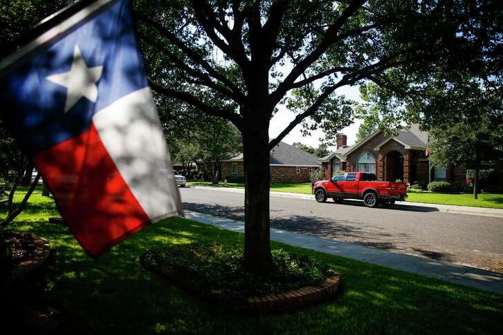 A Texas flag flies outside a home on Bradford Court where residents who own their mineral rights have been contacted about leasing by oil and gas companies looking to expand their operations under the city limits Thursday, Sept. 15, 2016 in Midland.