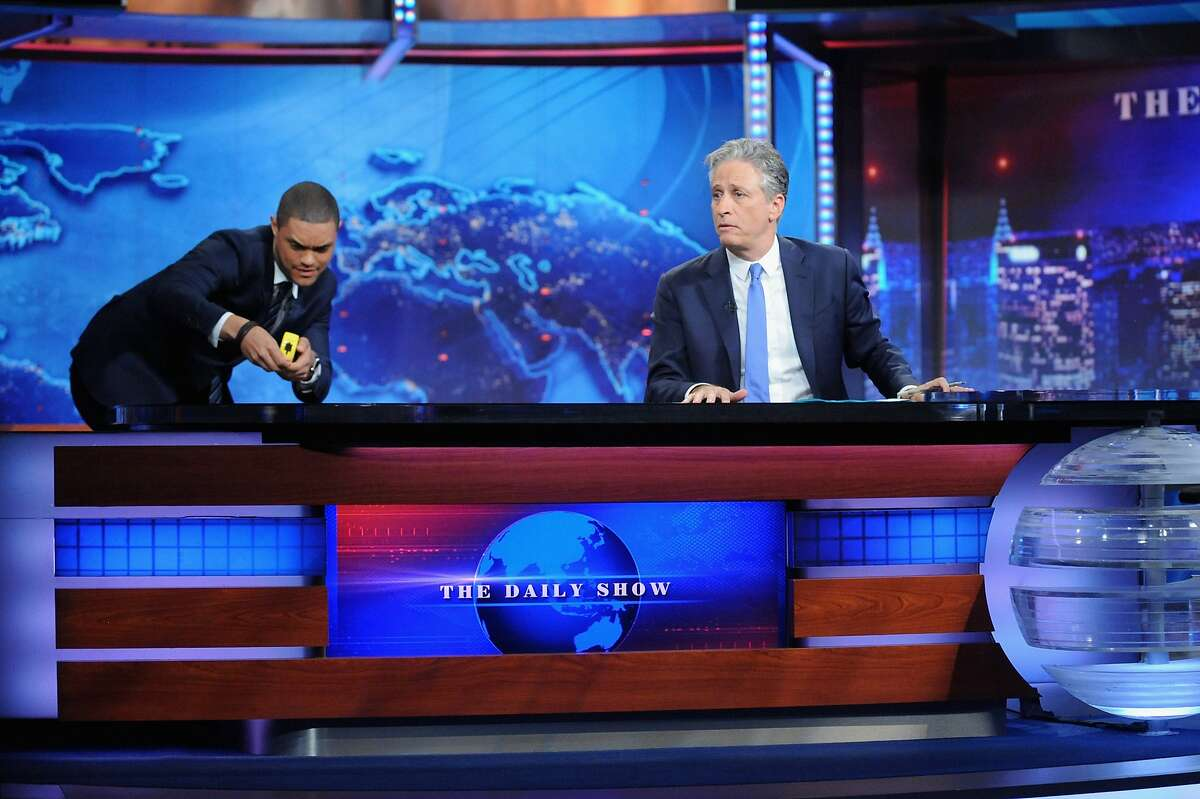 """NEW YORK, NY - AUGUST 06: Trevor Noah and host Jon Stewart appear on """"The Daily Show with Jon Stewart"""" #JonVoyage on August 6, 2015 in New York City. (Photo by Brad Barket/Getty Images for Comedy Central)"""