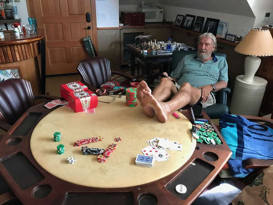 Don Nelson watches Game 5 of the Warriors-Rockets series from the poker room of his house in Maui. He says he never leaves the island anymore, but he watching every Warriors game. Photo: Scott Ostler / The Chronicle