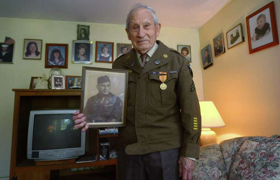 Nick Samodel, grand marshal for the 2018 Norwalk Memorial Day Parade, at his home Friday in Norwalk. The 97-year-old veteran served as an aircraft mechanic in the U.S. Army Air Corps during World War II. Stationed in northeast India, he serviced C-46 transport planes that hauled food, fuel, ammunition and mules over the nearby Himalaya into China to supply Chiang Kai-sheks nationalist forces and other allied troops fighting the Japanese. Photo: Erik Trautmann / Hearst Connecticut Media / Norwalk Hour