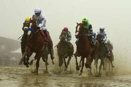 Justify, shown here at the head of the pack, wins the 143rd Preakness Stakes in the mud and fog May 19, capturing the second leg of the Triple Crown on May 19 in Baltimore. A reader was thrilled by the ride.