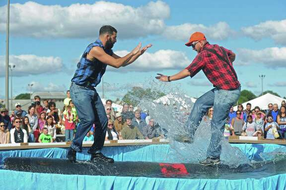 Mambers of the The Paul Bunyan Lumberjack Show perform the log roll during the 40th annual Oyster Festival last fall in Norwalk, Conn. The log roll was inspired by the Paul Bunyan tall tales.