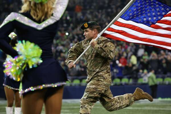 Green Beret Jeremy Bruffett carries out the U.S. Flag before the Seahawks game against Atlanta, Monday, Nov. 20, 2017 at CenturyLink Field.  (Genna Martin, seattlepi.com)
