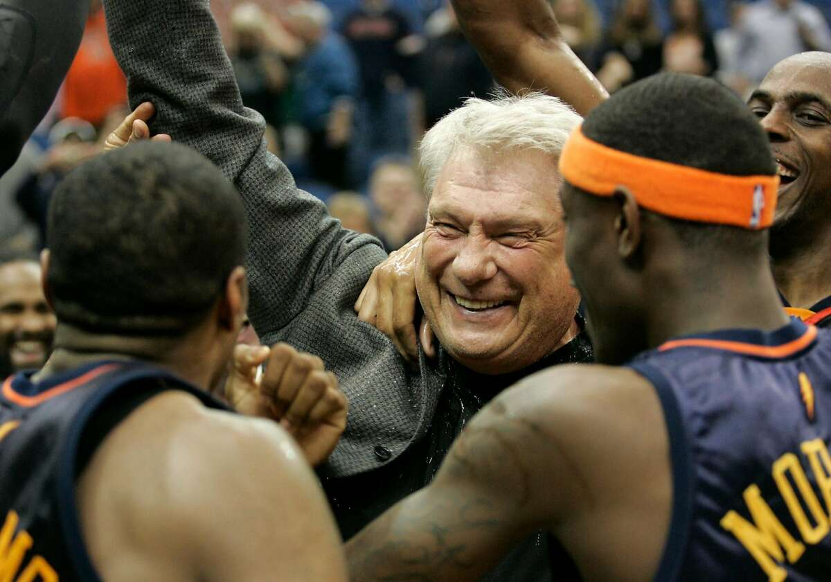 Golden State Warriors coach Don Nelson celebrates with his team after breaking the record for career coaching victories after the Warriors beat the Minnesota Timberwolves 116-107 in an NBA basketball game Wednesday, April 7, 2010, in Minneapolis. It was Nelson's 1,333rd win, moving him past Lenny Wilkens. (AP Photo/Paul Battaglia)