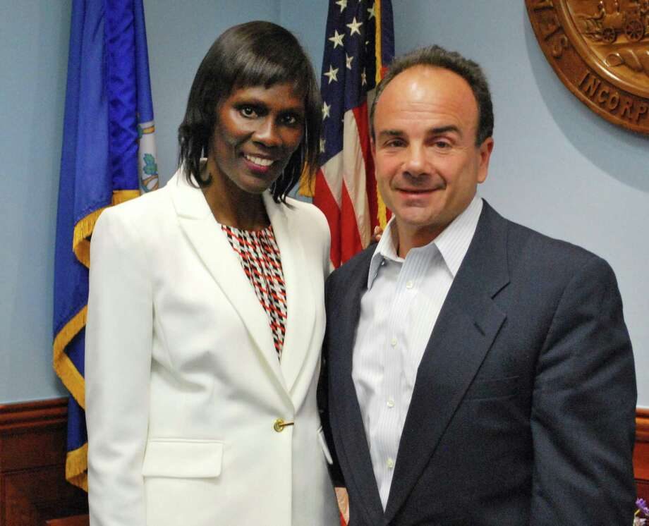 Kimberly Staley, with Mayor Joe Ganim, was formally announced as an assistant chief administrative officer in Bridgeport, Conn. on Thursday, July 21, 2016.  Staley will focus on social services and helping ex-offenders find jobs and other post-prison support. Photo: Contributed Photo / Contributed Photo / Connecticut Post contributed
