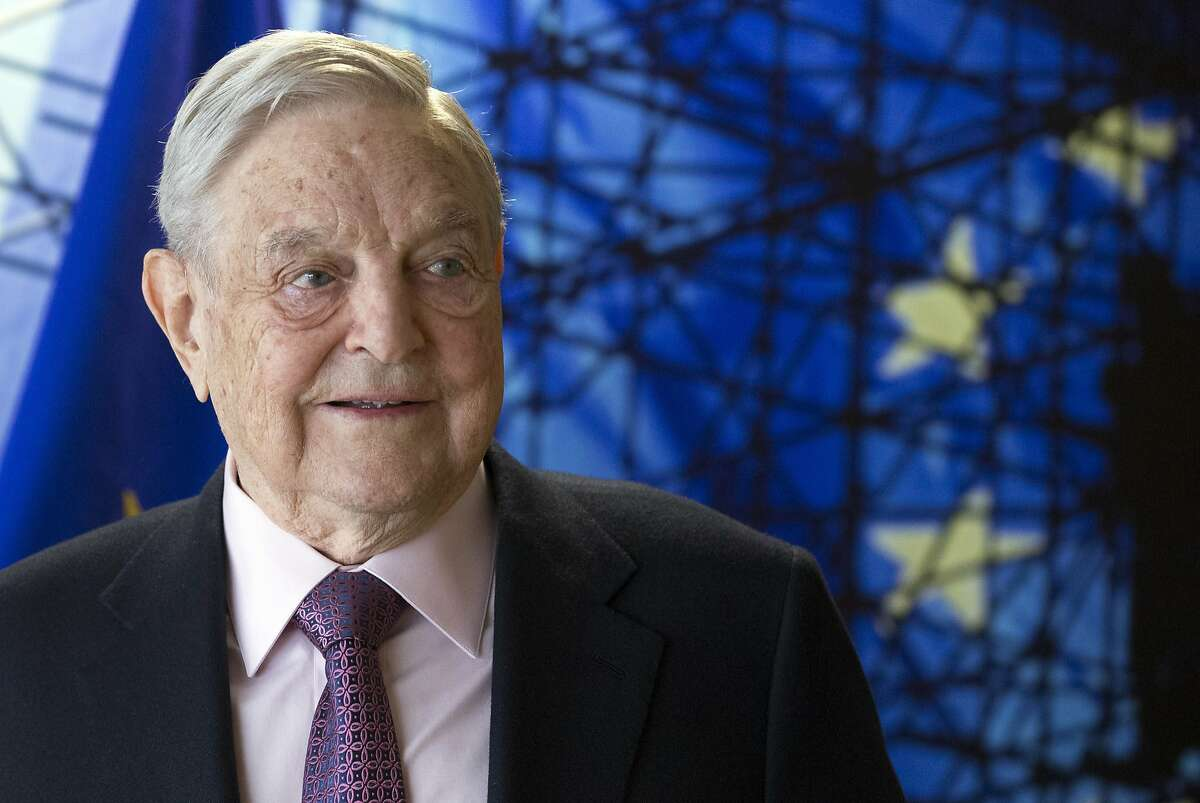 FILE - This Thursday, April 27, 2017 file photo shows George Soros, Founder and Chairman of the Open Society Foundation, before the start of a meeting at EU headquarters in Brussels. Through the California Justice & Public Safety Political Action Committee, Soros' plunked $1.5 million into several California district attorney's campaigns including the races in Alameda, Contra Costa, Sacramento and San Diego counties. (Olivier Hoslet, EPA via AP, Pool,File)