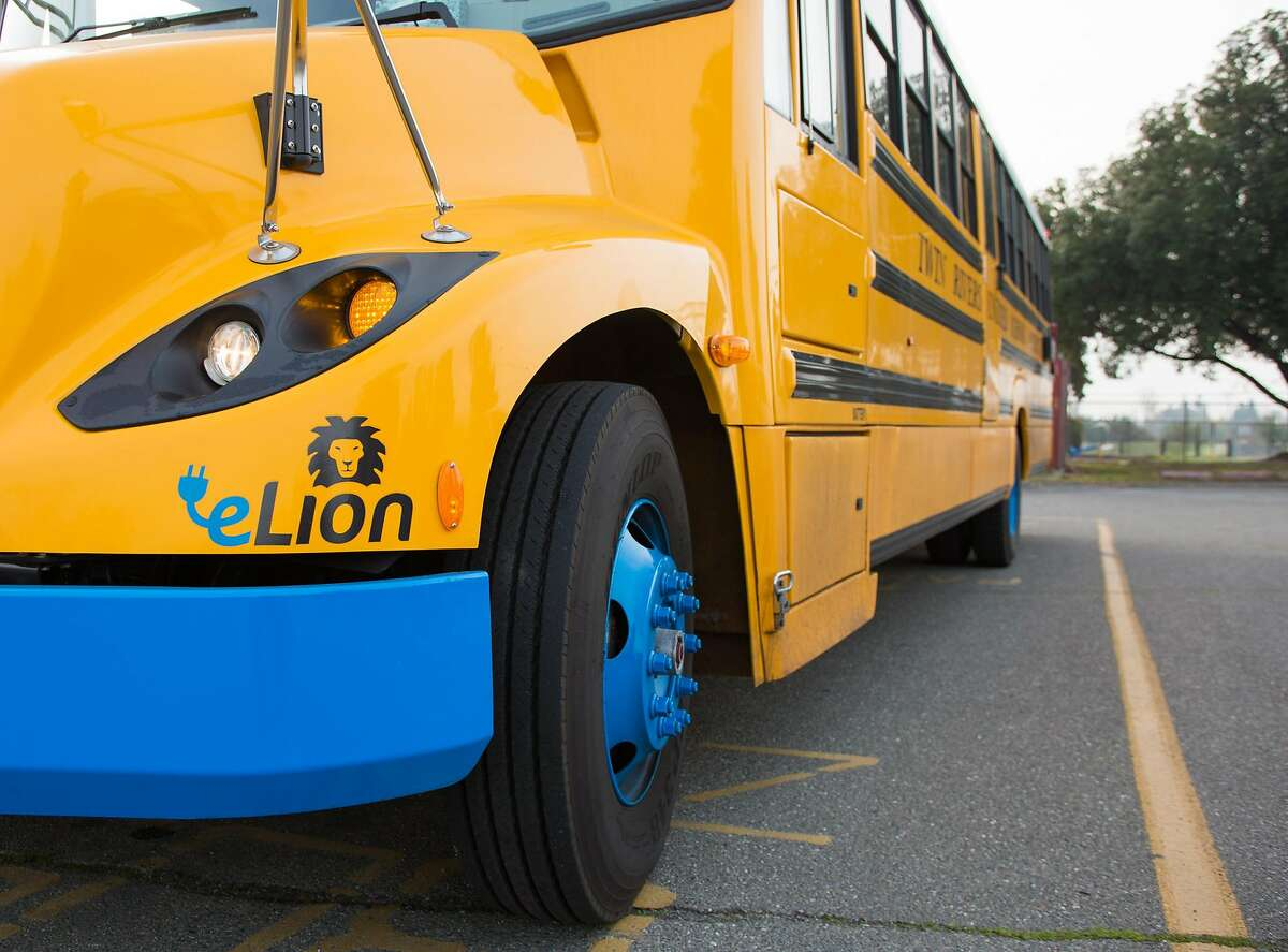 An electric school bus sits in front of Vineland Preschool in Sacramento, California, Friday, December 15, 2017. The blue bumper and rims differentiate the electric buses from normal buses.