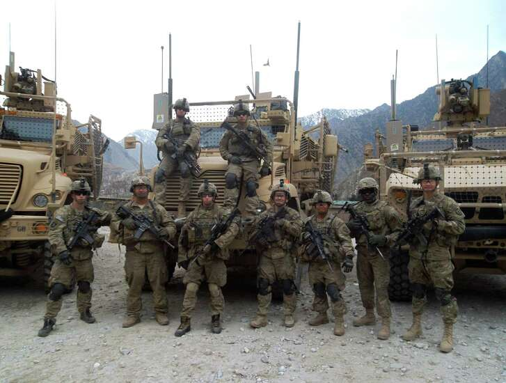 2nd Lt. Clovis Ray, far right, stands with his men at a base in Kunar province, Afghanistan