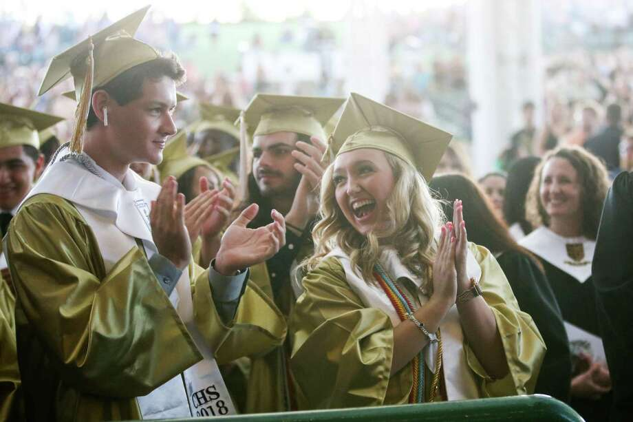 Graduates laugh and applaud as they appear on a projector during the Conroe High School graduation on Thursday, May 24, 2018, at The Cynthia Woods Mitchell Pavilion. Photo: Michael Minasi, Staff Photographer / Houston Chronicle / © 2018 Houston Chronicle