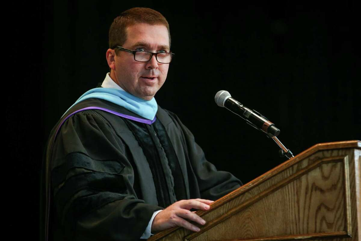 Conroe Principal Mark Weatherly speaks during the Conroe High School graduation on Thursday, May 24, 2018, at The Cynthia Woods Mitchell Pavilion.