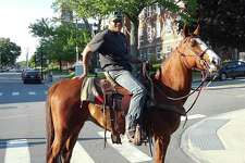 """Dominek Spear and his horse Chrissy took a ride down Main Street in Torrington Thursday night, as the class of 2018 of Northwestern Connecticut Community College was graduating at the Warner Theatre. Spear stopped to speak with a Torrington police officer, who was keeping an eye the street that was closed to traffic for the ceremonies. """"I wanted to see the graduation,"""" Spear said with a laugh, before he and Chrissy headed up Main Street."""