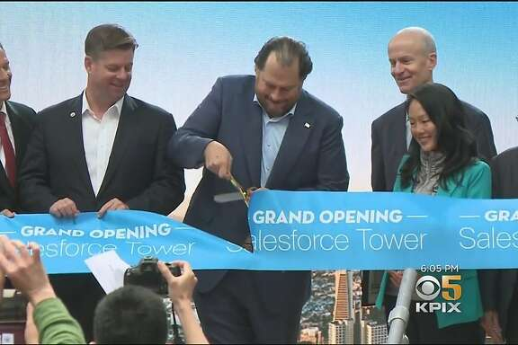 Salesforce CEO Marc Benioff is flanked by Mayor Mark Farrell to his left and Supervisor Jane Kim to his right, along with Boston Properties CEO Owen Thomas and others at the May 22 ribbon cutting for the Salesforce Tower in downtown San Francisco.