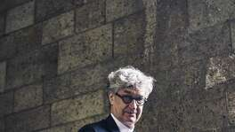 "Wim Wenders at the Cloisters, the Metropolitan Museum of Art's serene home for religious art in Upper Manhattan, on May 16, 2018. His latest film, ""Pope Francis: A Man of His Word,"" is a documentary exploring the life and philosophy of the Argentine pontiff.  (An Rong Xu/The New York Times)"