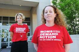 Greenwich residents, Michele Voigt, left,  and Jen Barro, members of the Greenwich chapter of Moms Demand Action, part of a national organization dedicated to lessening gun violence, in front of Greenwich Library, Conn., Friday, May 25, 2018.