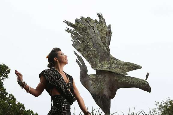 "Rosalia Webster, artist and Big Sur native, photographed near The Phoenix Bird sculpture at Nepenthe restaurant in Big Sur, Calif. on Tuesday, May 22, 2018. The sculpture is the inspiration for much of her art and was made by the famed sculptor Edmund Kara. The performance event, ""Big SurCus,"" is the brainchild of Webster, a burlesque dancer and performer who has built a show looking back at Big Sur's influence in the Golden Age of Hollywood. It will be staged this summer on the grounds of the Henry Miller Library in Big Sur."