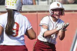 St. Joseph Hannah Hutchison (2) celebrates after scoring on a Madison Fitzgerald hit in the first inning against Trumbull in a FCIAC Softball Finals at Sacred Heart University on May 25, 2018 in Fairfield, Connecticut. St. Joseph defeated Trumbull 6-0.