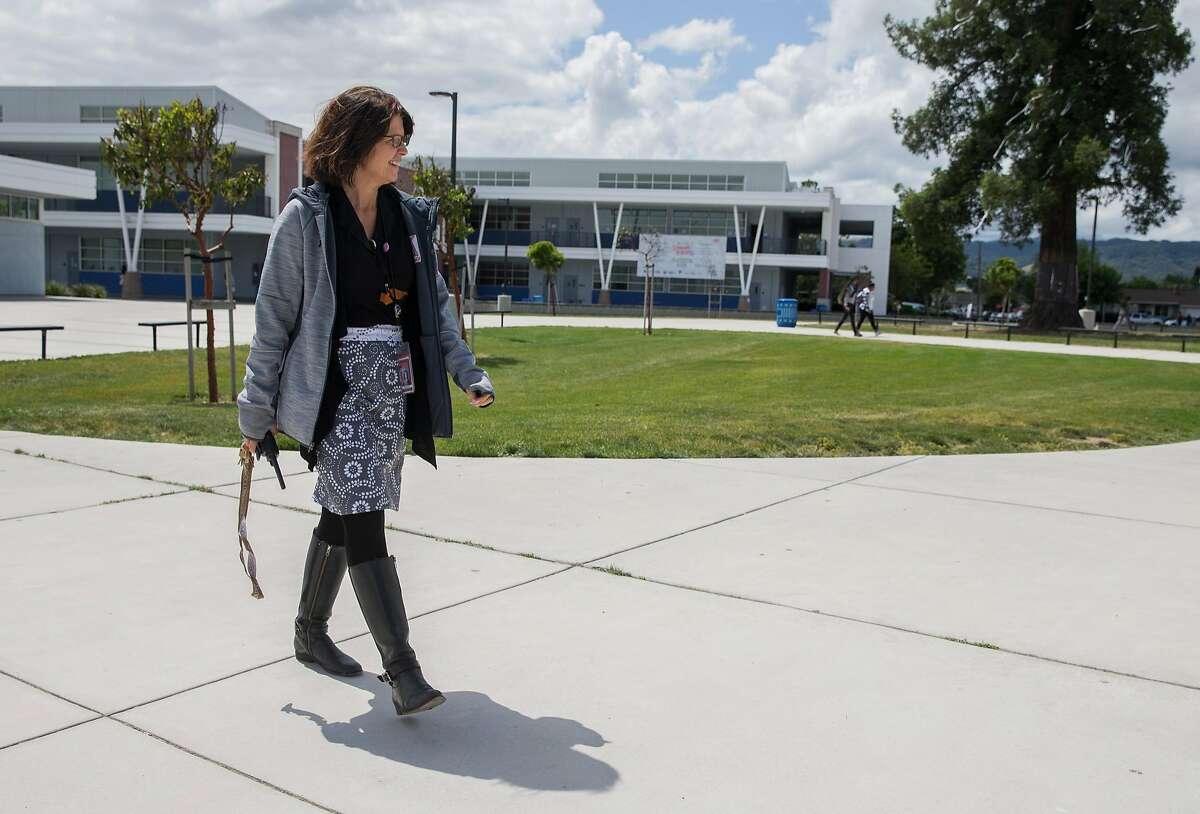 Dublin High School Principal Maureen Byrne walks through the campus of Dublin High School in Dublin, Calif. Wednesday, May 16, 2018.