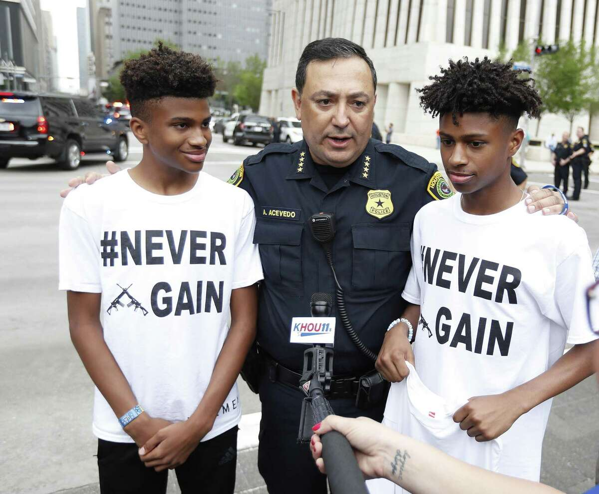 Houston Police Chief Art Acevedo talks with Harrison Maxwell, 15, and his brother, Maxwell, 13, during the March for Our Lives protest and march starting at Tranquility Park, Saturday, March 24, 2018, in Houston. After the mass shooting at Stoneman Douglas High School in Parkland, Florida, students of the school organized a nationwide protest, including in Houston, to plea for a strengthening of gun laws.