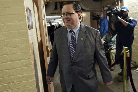FILE - in this Dec. 19, 2017 file photo, Rep. Blake Farenthold, R-Texas, arrives on Capitol Hill in Washington. Former Rep. Farenthold has accepted a $160,000 annual salary to lobby for a Texas port, mere weeks after resigning amid fallout from a sexual harassment scandal. The Calhoun Port Authority announced Monday May 14, 2018, that Farenthold would promote its interests in Washington. He quit in April, as the House Ethics Committee investigated his using $84,000 in taxpayer funds to settle an ex-staffer's 2014 sexual harassment claim. Farenthold pledged to reimburse that, but hasn't. (AP Photo/Susan Walsh File)