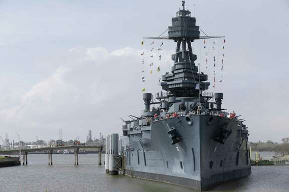 People are shown during a program on the Battleship Texas on Feb. 18, 2018, in Houston. The event was in commemoration of the 73rd anniversary of the Battle of Iwo Jima.