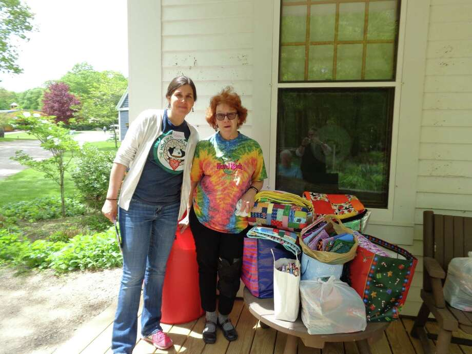 Hearthside Quilters members delivered 126 pillowcases and 20 quilts to the Hole In the Wall Gang camp on May 20. Photo: Hearthside Quilters / Contributed Photo /