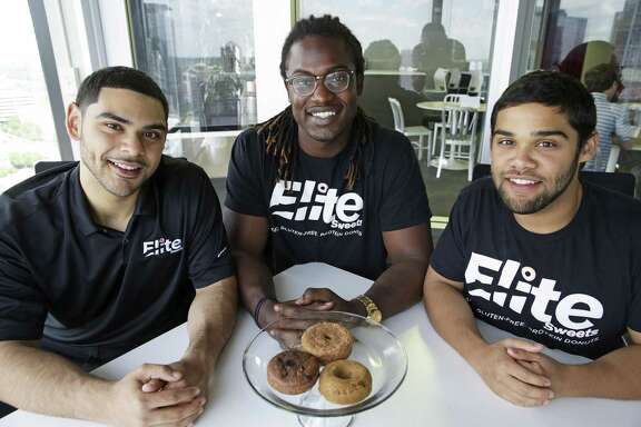 Elite Sweets creates protein donuts for athletes and fitness training on May 22, 2018.  From left are Amin Bahari, Timothy Cole and Amir Bahari.