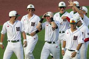Shane Sirdashney, center, reacts surrounded by teammates after defeating Klein 2-1 in Game 2 of their Region II-6A semifinal series to complete the sweep at Sam Houston State University on Friday.