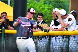 Edwardsville first baseman Drake Westcott makes a catch near the O'Fallon dugout in the first inning of Friday's Class 4A Edwardsville Regional championship game at Tom Pile Field.