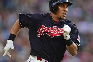 Cleveland Indians' Michael Brantley runs after hitting a double off Houston Astros starting pitcher Dallas Keuchel during the third inning of a baseball game Friday, May 25, 2018, in Cleveland. (AP Photo/David Dermer)