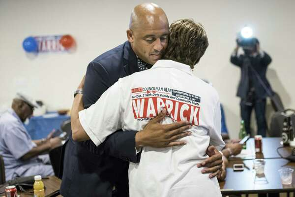 Incumbent City Councilman for District 2 Alan Warrick hugs his mother Cynthia Warrick during the election watch party for District 2's Councilman Alan Warrick at the American Legion on Martin Luther King Dr. in San Antonio, TX on Saturday, June 10, 2017.