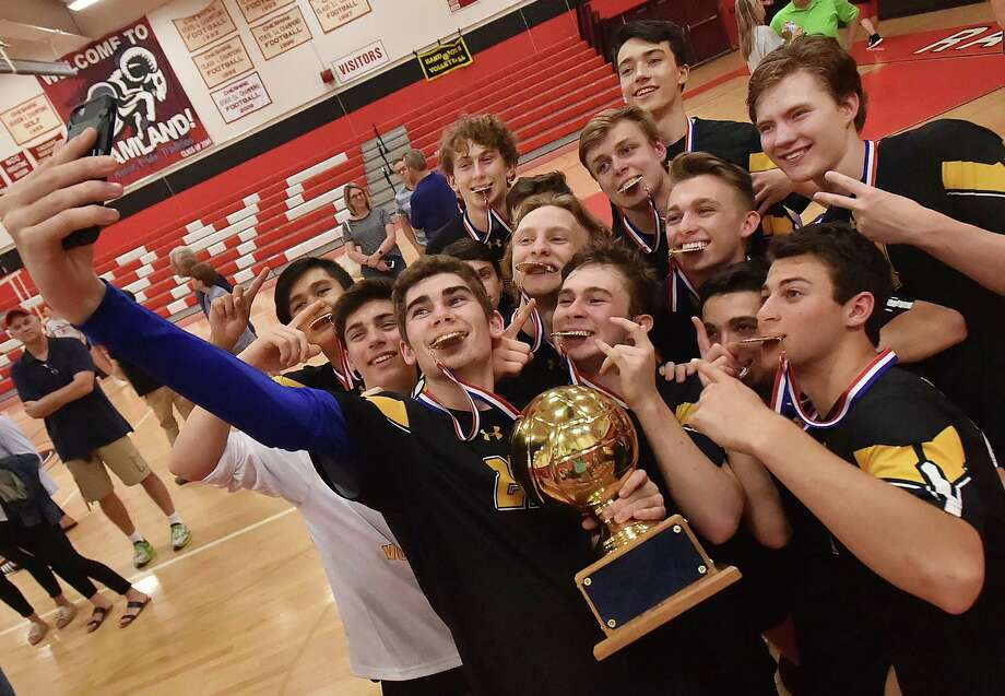 Daniel Hand senior captain Michael Card (22) takes a selfie with his teammates after beating Cheshire for the SCC championship title, Friday, May 25, 2018, at Cheshire High School. Hand won,  3-1. (25-17 H, 25-22 H, 25-22 C, 25-18 H) Photo: Catherine Avalone, Hearst Connecticut Media / New Haven Register