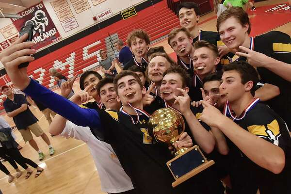 Daniel Hand senior captain Michael Card (22) takes a selfie with his teammates after beating Cheshire for the SCC championship title, Friday, May 25, 2018, at Cheshire High School. Hand won,  3-1. (25-17 H, 25-22 H, 25-22 C, 25-18 H)