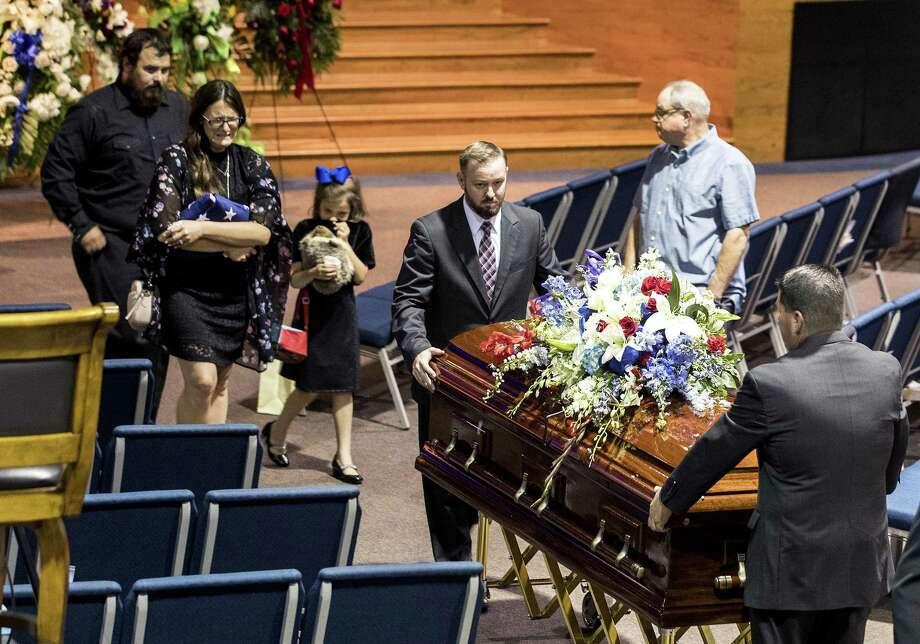 Christian Riley Garcia's casket is followed by his family as he is escorted from the sanctuary at Crosby Church following his funeral on Friday, May 25, 2018, in Houston. The 15-year-old Santa Fe High School student was one of 10 people killed last Friday, May 18, 2018, during a mass shooting at the school. ( Brett Coomer / Houston Chronicle ) Photo: Brett Coomer, Staff / Houston Chronicle / © 2018 Houston Chronicle