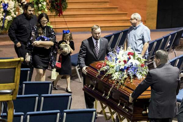 Christian Riley Garcia's casket is followed by his family as he is escorted from the sanctuary at Crosby Church following his funeral on Friday, May 25, 2018, in Houston. The 15-year-old Santa Fe High School student was one of 10 people killed last Friday, May 18, 2018, during a mass shooting at the school. ( Brett Coomer / Houston Chronicle )