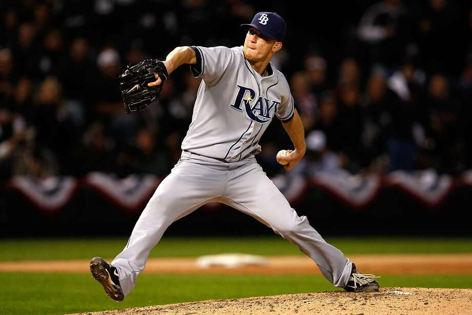 CHICAGO - OCTOBER 06:  J.P. Howell #39 of the Tampa Bay Rays throws a pitch against the Chicago White Sox in Game Four of the ALDS during the 2008 MLB Playoffs at U.S. Cellular Field on October 6, 2008 in Chicago, Illinois.  (Photo by Jamie Squire/Getty Images) Photo: Jamie Squire / Getty Images