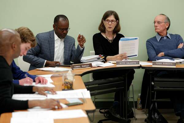 Commissioner Kitty Calavita, speaks to commission investigator Byron Norris during a Police Review Commission meeting in Berkeley, Calif., on Wednesday, May 23, 2018. The commission is pressing a charter amendment for the November ballot that would expand the body's powers, making it equivalent to its counterparts in Oakland, San Francisco and BART. Though there is resistance from the Berkeley Police Department, it's up for a City Council vote Tuesday.