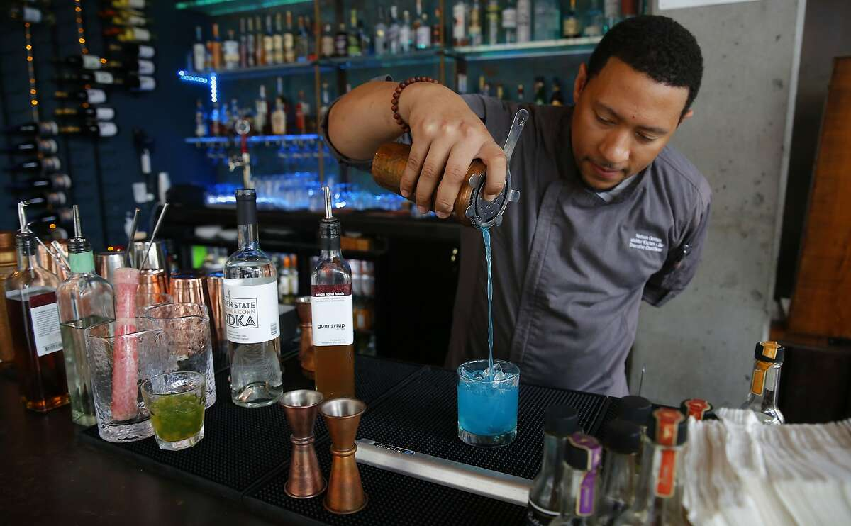 Chef and owner Nelson German creates a Golden State of Mind cocktail at alaMAR Kitchen in Oakland, Ca., as seen on Thurs. May 24, 2018.