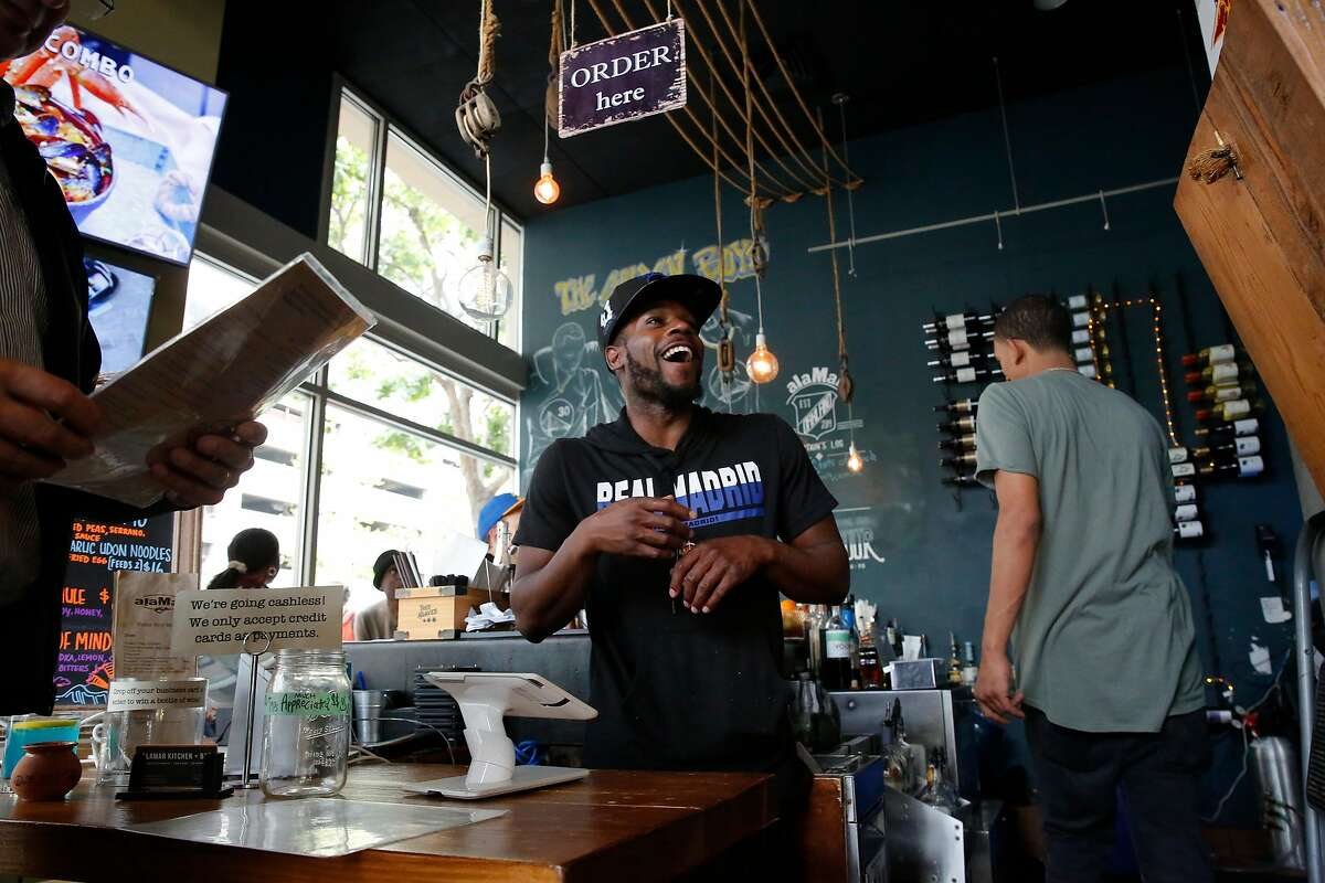 Antonio Johnson takes orders from patrons at alaMAR Kitchen in Oakland, Ca., as seen on Thurs. May 24, 2018.