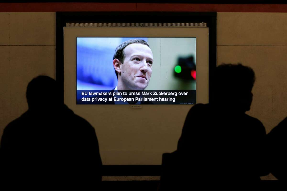 Facebook CEO Mark Zuckerberg is part of the scrolling news cycle on the video screens on the train platform at the Powell street BART station in San Francisco, Ca., as seen on Thurs. May 24, 2018.