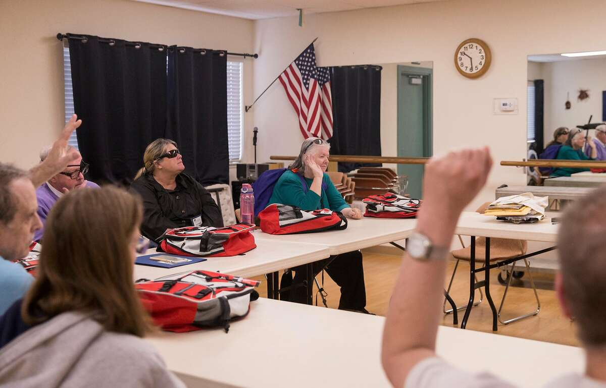 Members of the blind community and their loved ones gather at the Earle Baum Center in Santa Rosa, Calif. Thursday, May 3, 2018 for a fire safety training session following lessons learned after the North Bay fires in October 2016.