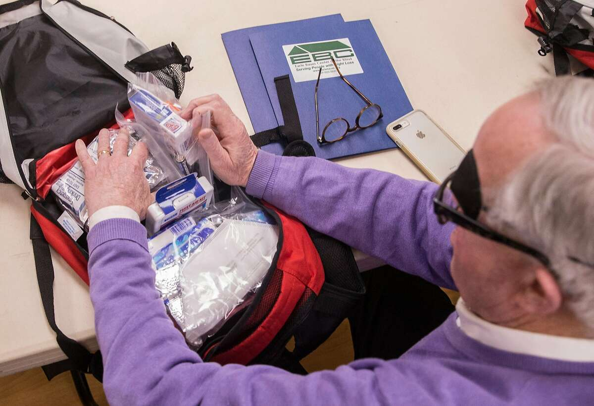 Bob Sonnenberg of Santa Rosa goes through a variety of items in a backpack provided as part of a fire safety training session for the blind community at the Earle Baum Center in Santa Rosa, Calif. Thursday, May 3, 2018