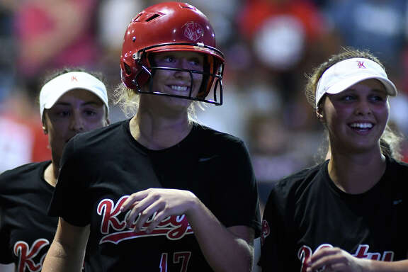 Katy junior Chloe Cobb (17) and teammate Kat Lopez (3) are all smiles after Cobb's homerun over the right field wall for the go ahead run against Atascocita in the top of the 9th inning of game 2 of their Region III Class 6A regional final series at Crosby High School on May 25, 2018. (Jerry Baker/For the Chronicle)