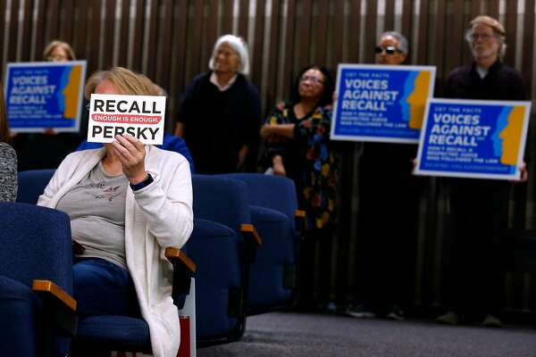 Recall supporter Belinda Stow and opponents of the effort (background) attends a meeting of the Santa Clara County Board of Supervisors, who were expected to approve a ballot measure to recall Judge Aaron Persky in San Jose, Calif. on Tuesday, Feb. 6, 2018. Persky came under fire for handing down a six-month sentence to former Stanford athlete Brock Turner after a conviction on sexual assault.