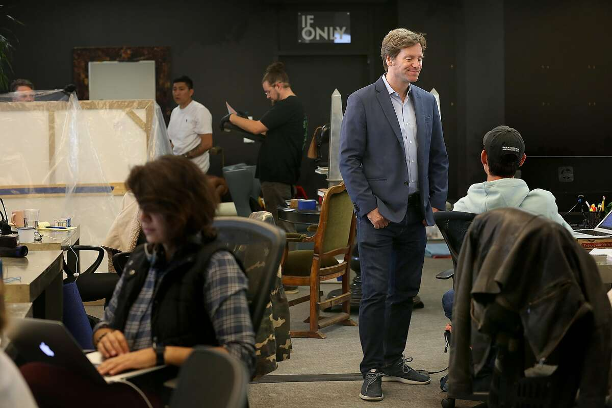 SF tech entrepreneur and socialite Trevor Traina (middle right) works in his office where art is being packaged and transported on Tuesday, May 15, 2018 in San Francisco, Calif. Traina will be accepted as Ambassador to Austria at a special ceremony at the Presidential Palace in Vienna.