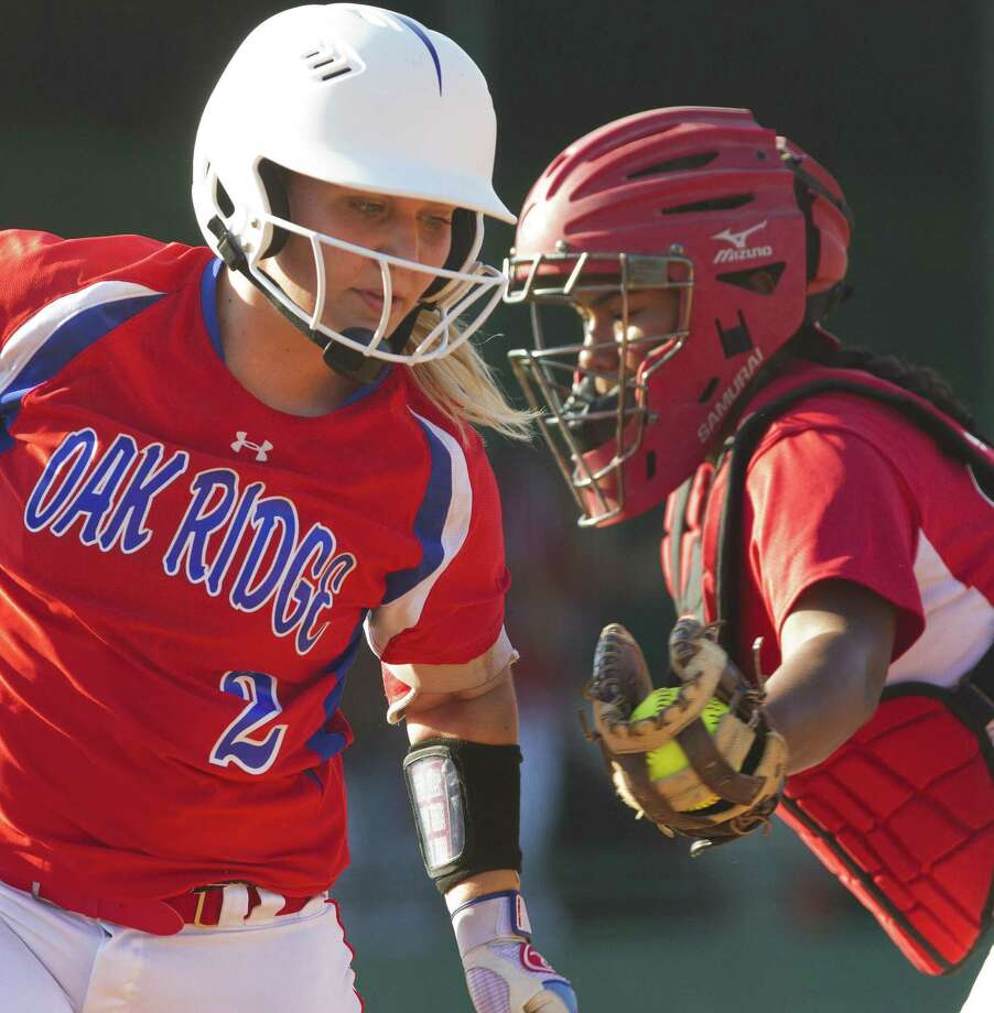 Kenzie Mays #2 of Oak Ridge tries to avoid the tag by MacArthur catcher IIIyana Camacho (12) in the first inning of Game 2 during a Region II-6A semifinal series at Montgomery High School, Friday, May 18, 2018, in Montgomery. Photo: Jason Fochtman, Staff Photographer / Houston Chronicle / © 2018 Houston Chronicle