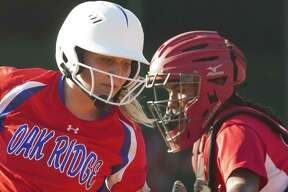 Kenzie Mays #2 of Oak Ridge tries to avoid the tag by MacArthur catcher IIIyana Camacho (12) in the first inning of Game 2 during a Region II-6A semifinal series at Montgomery High School, Friday, May 18, 2018, in Montgomery.