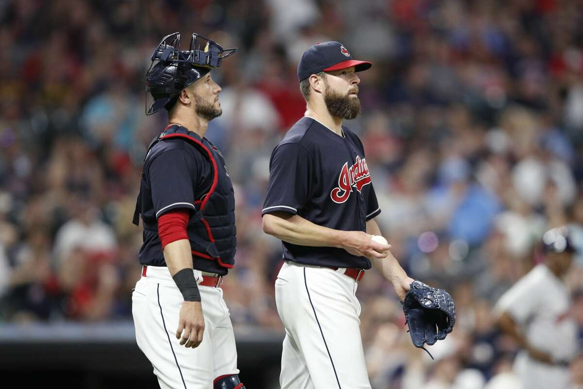 CLEVELAND, OH - MAY 25: Corey Kluber #28 and Yan Gomes #7 of the Cleveland Indians look on prior to a pitching change in the seventh inning against the Houston Astros at Progressive Field on May 25, 2018 in Cleveland, Ohio. (Photo by Joe Robbins/Getty Images)