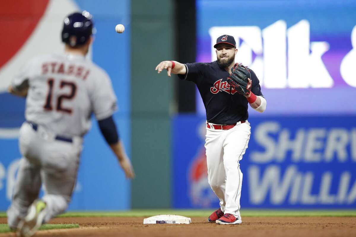 CLEVELAND, OH - MAY 25: Jason Kipnis #22 of the Cleveland Indians turns a double play in the seventh inning against the Houston Astros at Progressive Field on May 25, 2018 in Cleveland, Ohio. (Photo by Joe Robbins/Getty Images)