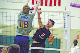 Edwardsville senior Bob Dresner, right, goes up for a kill during the second game of Friday's sectional semifinal against O'Fallon at Metro-East Lutheran.